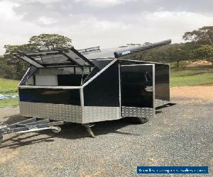Enclosed motobike trailer with attached side tent and awnings. for Sale